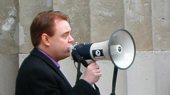 Falkvinge with megaphone. Photo by Ahruman@FlickR, CC.