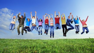 Big group of young people jumping with joy