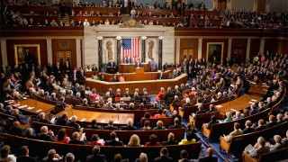 The United States Congress in session. Con-gress is the opposite of pro-gress.