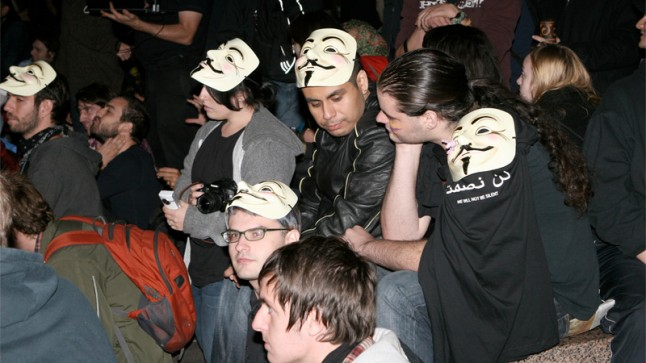 Photo of people wearing Anonymous masks in a way that doesn't actually cover their faces. I'm definitely not in this photograph. Not at all. I swear.