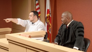 Witness at trial, pointing at someone