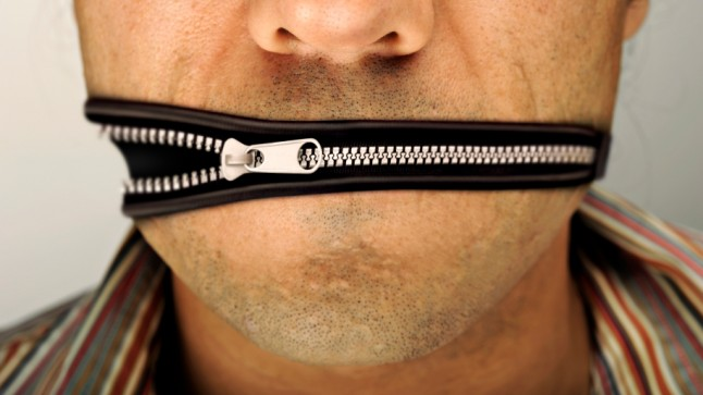Man being silenced: his mouth is replaced by a zipper