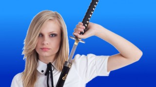 Blond hair businesswoman with katana sword