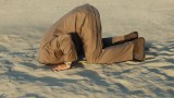 Businessman sticking head in sand