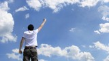 Man stretching his hand victoriously to the sky