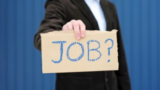 "Person holding cardboard ""Job?"" sign"