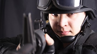 Militarized police, aiming at viewer