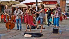 A musical group busking in a public square