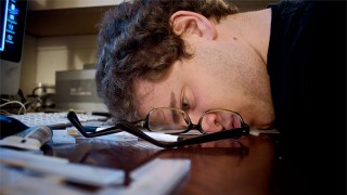 Man slamming his head on a desk in frustration - CC photo by Flickr user mbshane