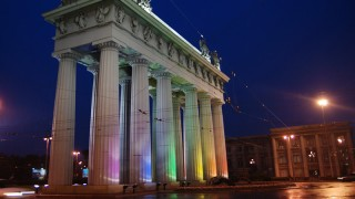 The Moscow Triumphal Gate lit up witih rainbow lights - CC photo from Wikimedia Commons