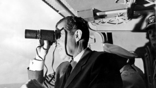 U.S. President Nixon looking through binoculars. Photo courtesy of NASA.