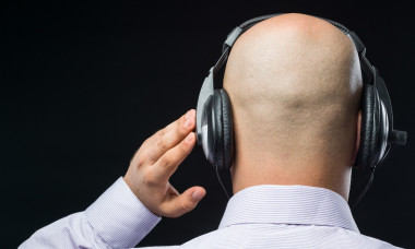 bald-headed-man-with-headphone-picture-id618944450-2