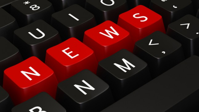"""Close-up of a keyboard with keys rearranged to spell out the word """"news"""""""