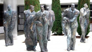 Statues of frozen businessmen