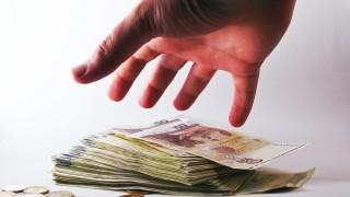 Hand grabbing cash
