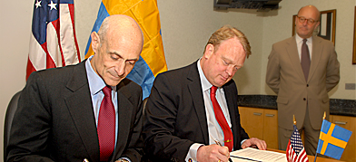 April 13, 2007. Swedish Minister of Defense, Odenberg (right), signs an agreement with the head of the U.S. Department of Homeland Security, Chertoff (left). Put in context, the effect of the agreement is to wiretap all of Russia's international traffic and share it with the NSA. What did Sweden get in return?