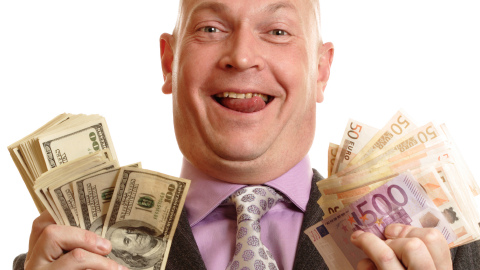 Happy Rich Businessman with US Dollars banknotes and Euro banknotes