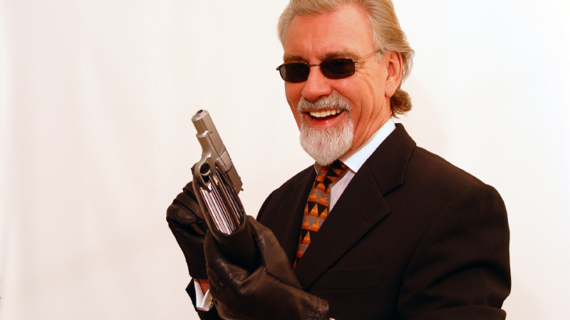 Elder elegant man with gun holding somebody's wallet