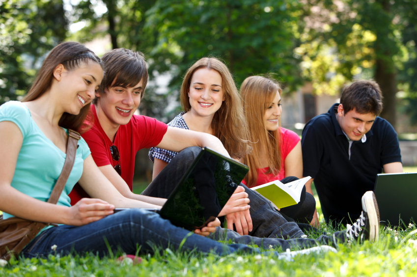 Group of college students studying at campus