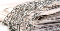 newspapers-chained-1280x720-istockphoto