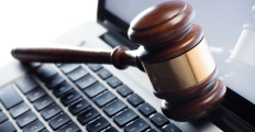 gavel-resting-on-a-laptop-computer-1280x720-istockphoto