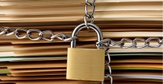 closeup-of-stacked-brown-file-folder-with-locked-padlock-picture-id598953630